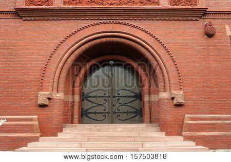 ancient arch door with brick wall in Harvard Campus