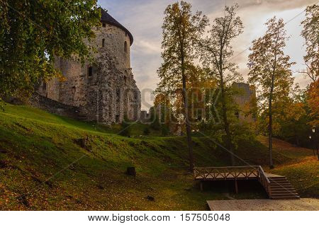 Autumn park with old castle ruins in Cesis town, Latvia