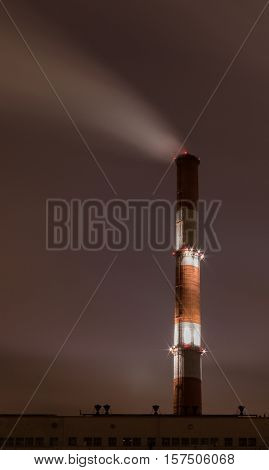 Smoke stack against sky at deep night
