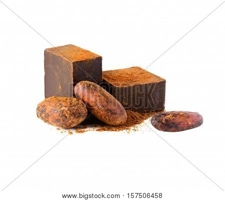 Dark chocolate, cocoa beans and cocoa powder isolated on white