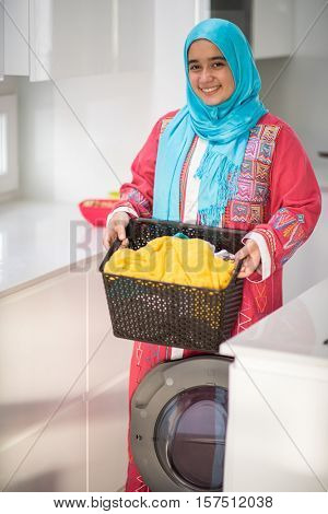 Muslim girl with laundry