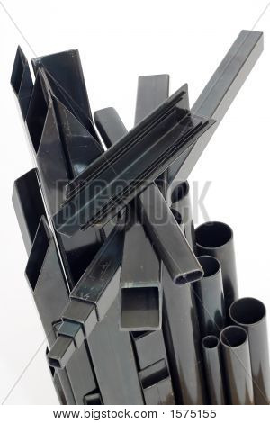 Rounded And Rectangular Welded Steel Pipes On White Background