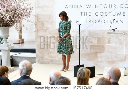 NEW YORK-MAY 5: First Lady of the United States Michelle Obama at ribbon cutting ceremony for Anna Wintour Costume Center Grand Opening at Metropolitan Museum of Art on May 5, 2014 in New York City.