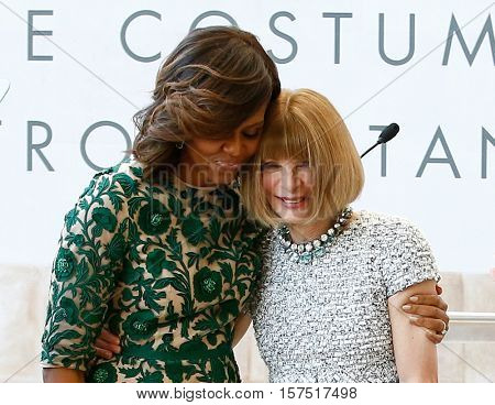 NEW YORK-MAY 5: Michelle Obama (L) and Anna Wintour at the Anna Wintour Costume Center Grand Opening at the Metropolitan Museum of Art on May 5, 2014 in New York City.