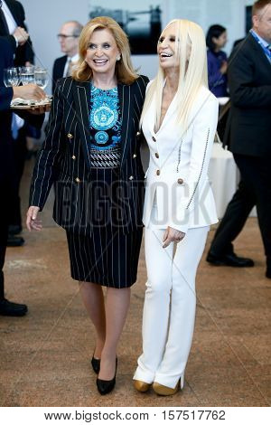 NEW YORK-MAY 5: Designer Donatella Versace (R) attends the ribbon cutting ceremony for the Anna Wintour Costume Center Grand Opening at the Metropolitan Museum of Art on May 5, 2014 in New York City.