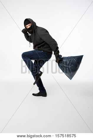 Thief slinking in black mask