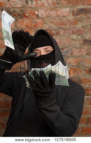 Burglar in mask throws bill