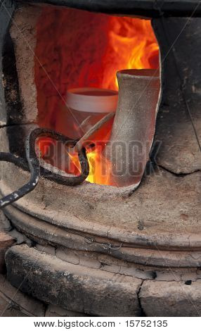 Old pottery kiln and pot. work process poster