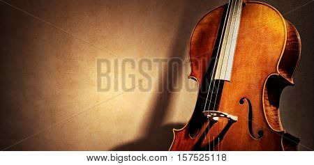 Cello background with silhouette and copy space for music concept