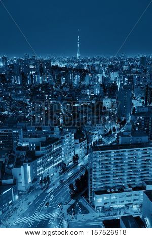 Tokyo Skytree and urban skyline rooftop view at night, Japan.