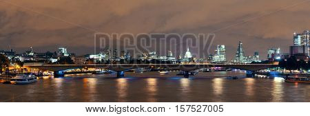 London cityscape at night with urban buildings over Thames River panorama