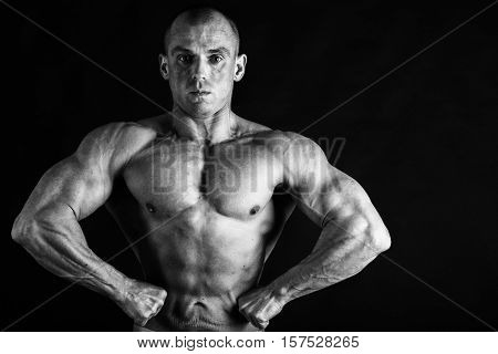 Bodybuilder posing in different poses demonstrating their muscles. Male showing muscles straining. Beautiful muscular body athlete.