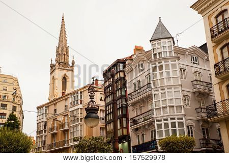 View of buildings and belltower of Sagrado Corazon church Santander