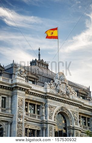 The Flag Of Spain Fluttering On Building Of The Bank Of Spain