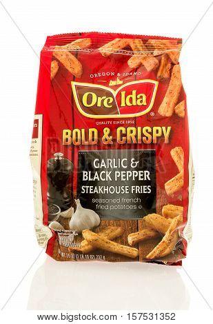 Winneconne WI - 20 November 2016: Bag of Ore Ida bold & crispy garlic & black pepper steakhouse fries on an isolated background.