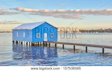 The blue Crawley Edge Boatshed is a well-recognized and frequently photographed site in Perth, Western Australia. It is thought to have been constructed in the early 1930s and has since been refurbished.
