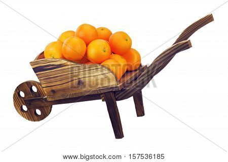 Oranges on pushcart isolated on white background.