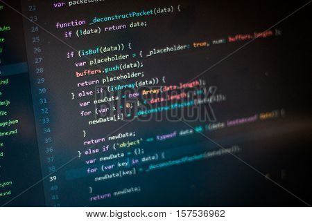 Programming abstract - source code and binary code on display of software developer.