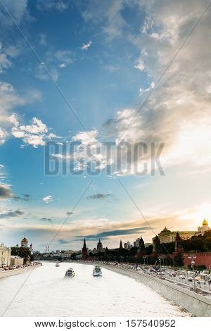 City landscape with the Moscow River with three ships Kremlin Embankment against the beautiful cloudy sunset sky