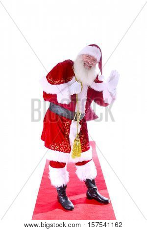 Old World Santa Claus walks the Red Carpet in a Fashion Photo Shoot. Isolated on white with room for your text.
