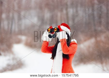 Curious Girl with Binoculars Looking for Christmas