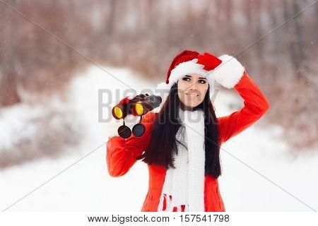 Happy Girl with Binoculars Looking for Christmas