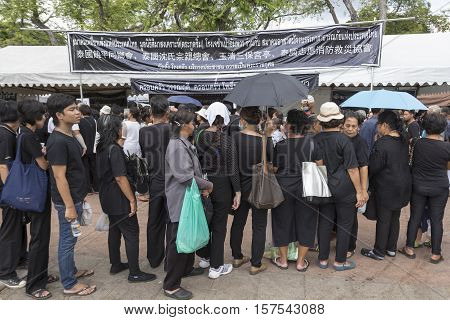 BANGKOK THAILAND - NOV 1 : line up of people for take donation in Sanam Luang while the funeral of king Bhumibol Adulyadej in Grand Palace on november 1 2016