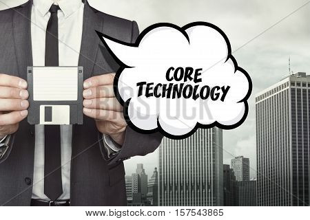 Core technology text on speech bubble with businessman holding diskette