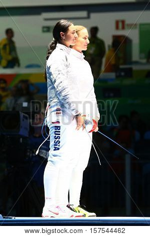 RIO DE JANEIRO, BRAZIL - AUGUST 8, 2016: Sofya Velikaya (L) and Yana Egorian of Russia before final in the Women's individual sabre of the Rio 2016 Olympic Games at the Carioca Arena 3