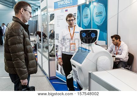 Moscow Russia November 4 2016: The 4rd International Exhibition of Robotics and advanced technologies Robotics Expo in Moscow.Visitors inspect the exposition of robots and new technologies
