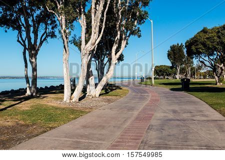 Sidewalk through the Chula Vista Bayfront Park with the San Diego Bay in the background.