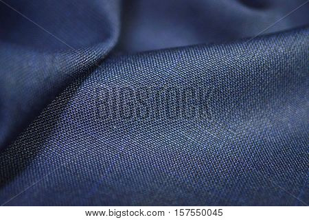close up texture blue fabric of suit photo shoot by depth of field for object