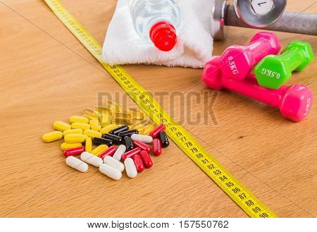 Drugs and fitness equipment on a table.