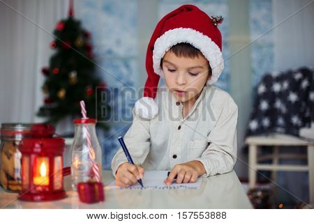 Preschool Child, Boy, Writing Letter To Santa At Home, While Snowing Outdoors