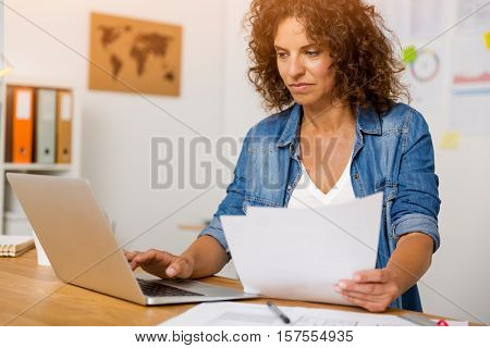 Middle age woman working at the office