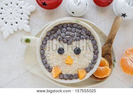 Penguin porridge oatmeal breakfast Fun Christmas food art for kids