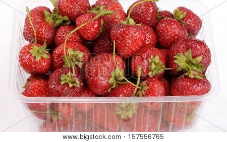 image of many Strawberry in plastic container