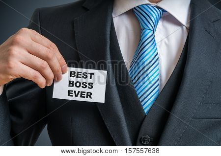 Self-confident Businessman In Suit Is Showing Label That He Is T
