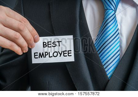 Self-confident Employee Is Showing Label That He Is The Best Emp