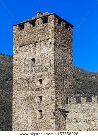 Torre Bianca tower of the medieval fortress Castelgrande in the city of Bellinzona, Switzerland. The fortress is a UNESCO World Heritage Site and also belongs to the Swiss Inventory of Cultural Property of National and Regional Significance.