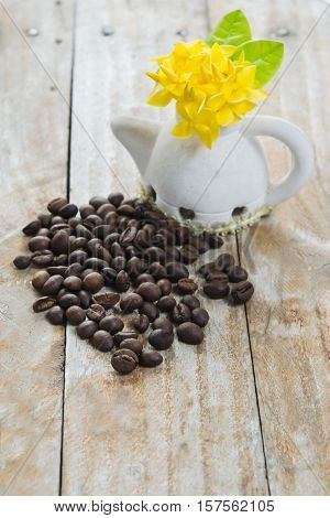 Coffee Beans On Grunge Wood Background With Ixora Flower Pot And Morning Light And Garden View