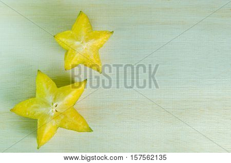 Star Apple Fruit With Half Cross Section Isolated On Wooden Board With Blank Copy Text Space