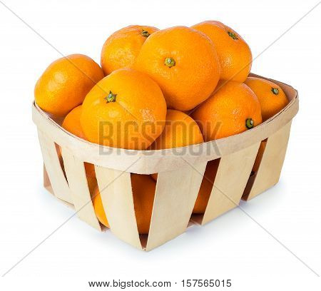 Tangerines in a basket isolated on white background. Mandarins in a basket isolate. Orange citrus fruits. Wicker basket full of multiple ripe orange fresh tangerines isolated over white background