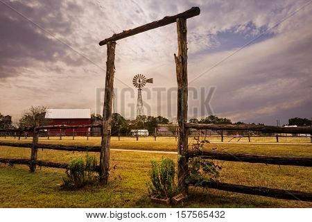 This is a landscape photo taken of a windmill at a ranch in Texas
