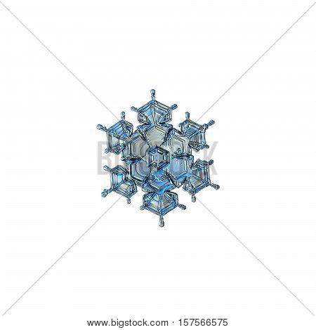 Snowflake isolated on white background: macro photo of real snow crystal, captured on sheet of glass with LED back light. This small stellar dendrite snowflake have beautiful arms and relief surface.