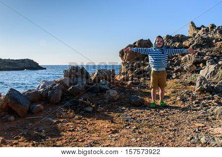 A boy of five years old walking on rocky terrain