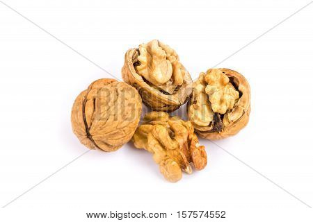 Walnut close up of nut with nutshell on white background