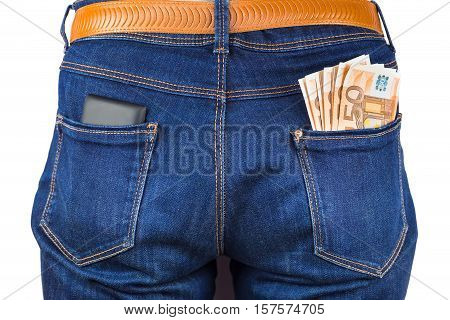 Mobile phone and euro notes in back pocket of blue jeans