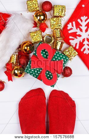 Feet on wood floor. Christmas holidays concept