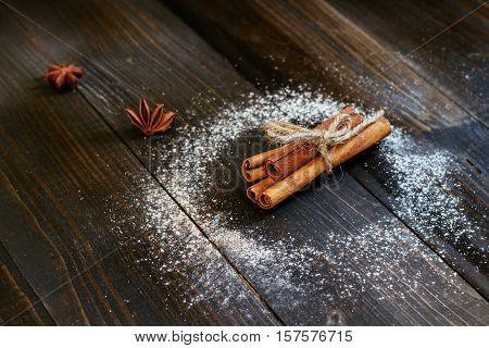 Cinnamon sticks on the black wooden table. Fresh cinnamon. Ground cinnamon.